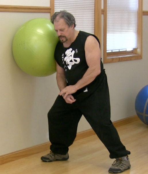 Teacher using Ball to Demonstrate Shoulder Stoke
